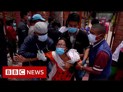 Families in Nepal forced to say goodbye through crematorium gates – BBC News