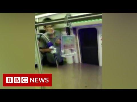 Twelve die as rain floods train tunnel in China – BBC News