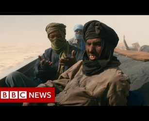 Fleeing the shifting sands of the Sahara desert, due to climate change - BBC News